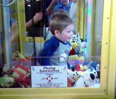 Boy_caught_in_toy_machine